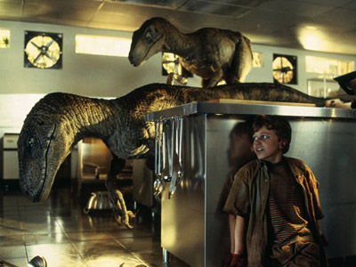 ... shots of the velociraptors are actually men wearing rubber suits. WHAT.